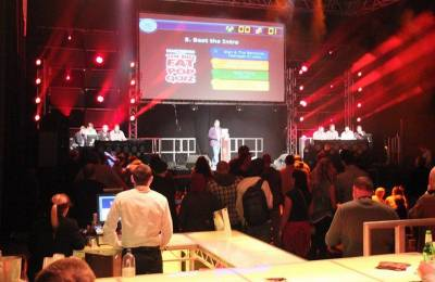 An MC on stage at a Creative Events Digi Quiz
