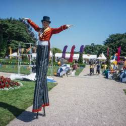 A stilt walker perfomer at a Creative Events Summer Family Fun Day