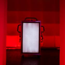 A image of the escape box on its own against red lights with a white light coming from the front of the box , designed by Creative Events