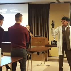 The Professor giving the teams the instructions needed to complete the task at an Escape Game event organised by Creative Events