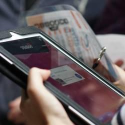 A team setting up their team name on an iPad at a Creative Events iPad Event