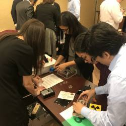 Team members working together to try and solve the puzzle in order to win the activity at a Escape Games event organised by Creative Events