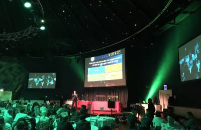 MC on stage at Creative Events Cube Gameshow