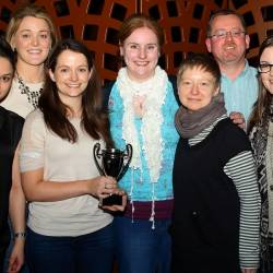 A winning team holding a trophy at a Creative Events Big Interactive Quiz event