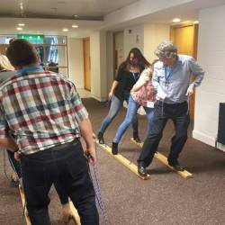 Two teams racing to win the landski competition at a Creative Events corporate team building activity