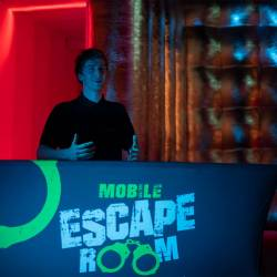 A staff member at the Mobile Escape Room registration desk