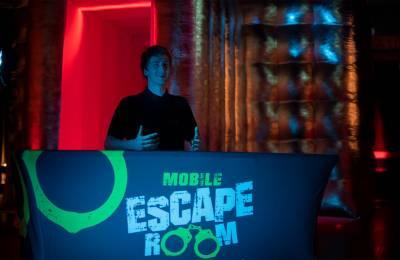 A staff member at the Mobile Escape Room registration desk