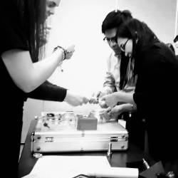 Teams working together to solve puzzles at a Creative Events table top escape game