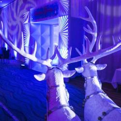 A winter wonderland entrance way with white reindeer at a Creative Events kids Christmas party