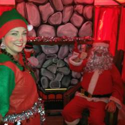 Santa and his elf in his grotto at a Creative Events kids Christmas party