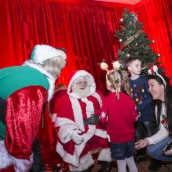 Children meeting Santa in his grotto at a Creative Events Kids Christmas party