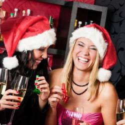 a group of people enjoying drink and wear Christmas hats at a Creative Events Christmas party