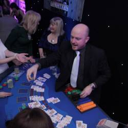A croupier dealing cards at a blackjack table at a Creative Events Christmas Party