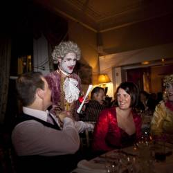 An actor converses with guests at a Creative Events Murder Mystery show