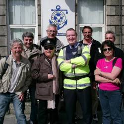 a team pose with a Garda at a Creative Events CSI event