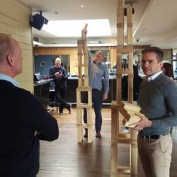 two teams attempting to build a structure taller than the others using giant jenga at a Creative Events company challenge event
